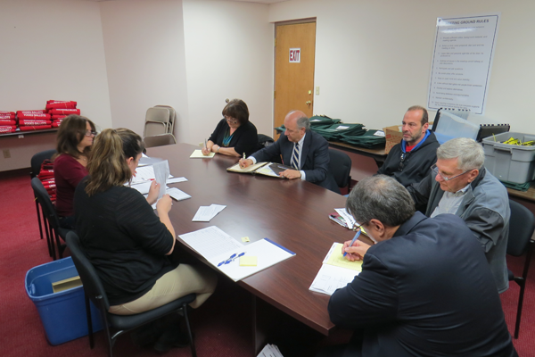 On hand to count the absentee and affidavit ballots Tuesday were Democrat Party Chairwoman Diane Perri Roberts and John DelMonte, far side of the table; candidate Dave Trane; and Republican Party Chairman Jerry Wolfgang and Damon DeCastro.