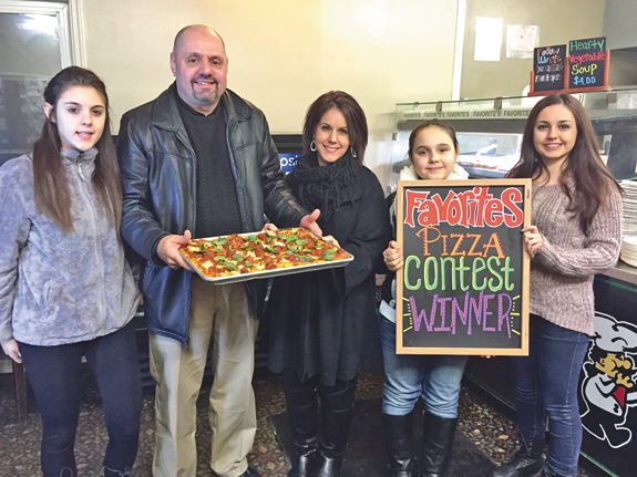 The Briglio family with `The Big Daddy Pizza` at Favorite's Pizzeria.