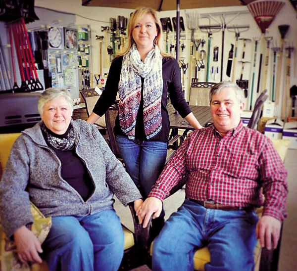 Gail and Bill Warren with daughter, Ashley, in the Portage Road store.