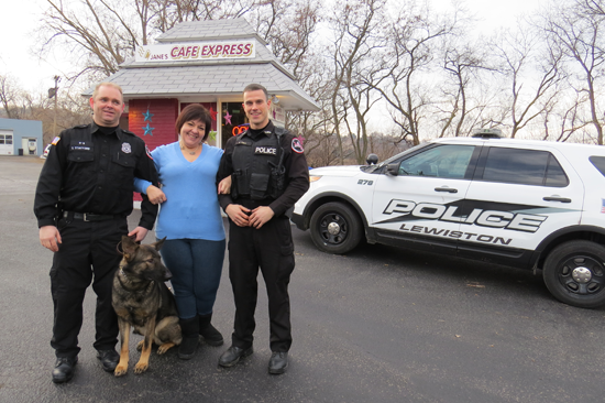 Pictured, Jane Kusmierz of Jane's Café Express puts her arms around loyal customers and Lewiston Police Department officers Scott Stafford and Brandon Hall. Taser looks on.