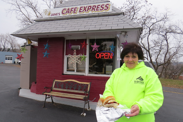 Jane's Café Express owner Jane Kusmierz stands in front of her Lewiston eatery.