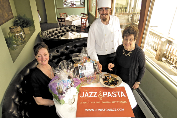 Pictured, Water Street Landing chef Dennis Danieu serves a plate of pasta to SideBar hostess Jayne Anderson (seated) and Anne Macri of Macri's Italian Grille, one of the restaurants serving food at the upcoming fundraiser. (Photo by Joshua Maloni)