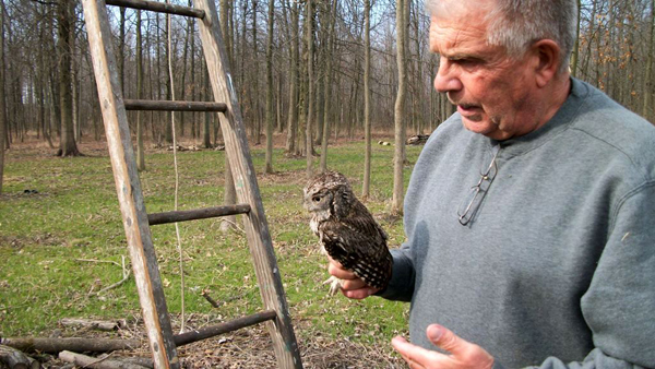 Jerry Farrell is shown with a screech owl.