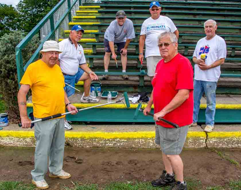 Pictured, from left: Ed Evert, Randy Gorska, President Marty Pauly, Bill Bennion, John Coulter and Dick Allen paint the Academy Park grandstands.