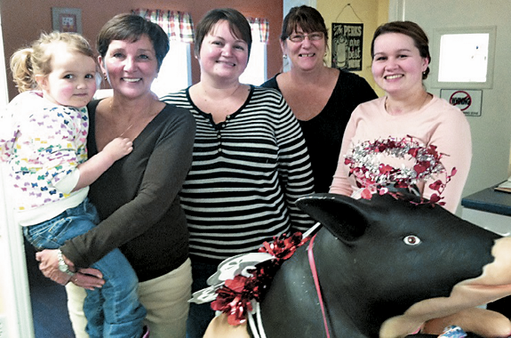 Debbie Parker (owner) with her granddaughter, Elliot and Amanda Parker, Jayne Held, Sarah Woolson and the famous Savannah the Pig.
