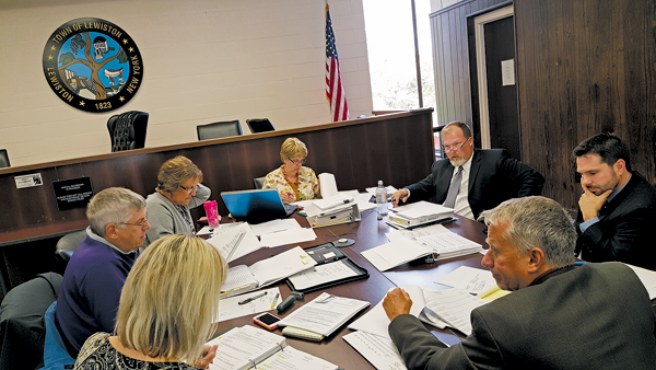 Town Board members review portions of the budget in detail Thursday at Town Hall. (Photo by Terry Duffy)