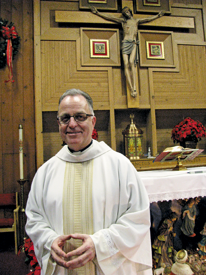 Monsignor David G. LiPuma is shown at the altar at St. Bernard's Church on Jan. 3. He will be the Youngstown church's temporary administrator, while continuing to serve as pastor at St. Peter R.C. Church in Lewiston. (Photo by Susan Mikula Campbell)