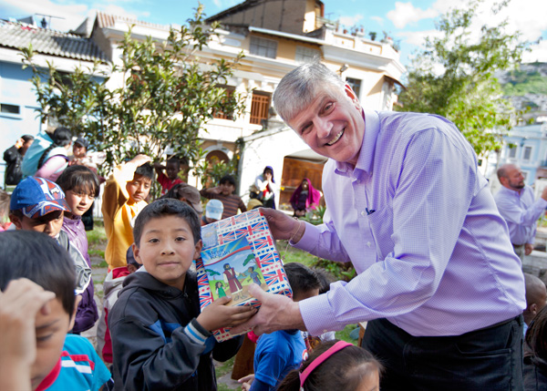 Franklin Graham stands with one of the Operation Christmas Child shoebox recipients. (submitted photo)