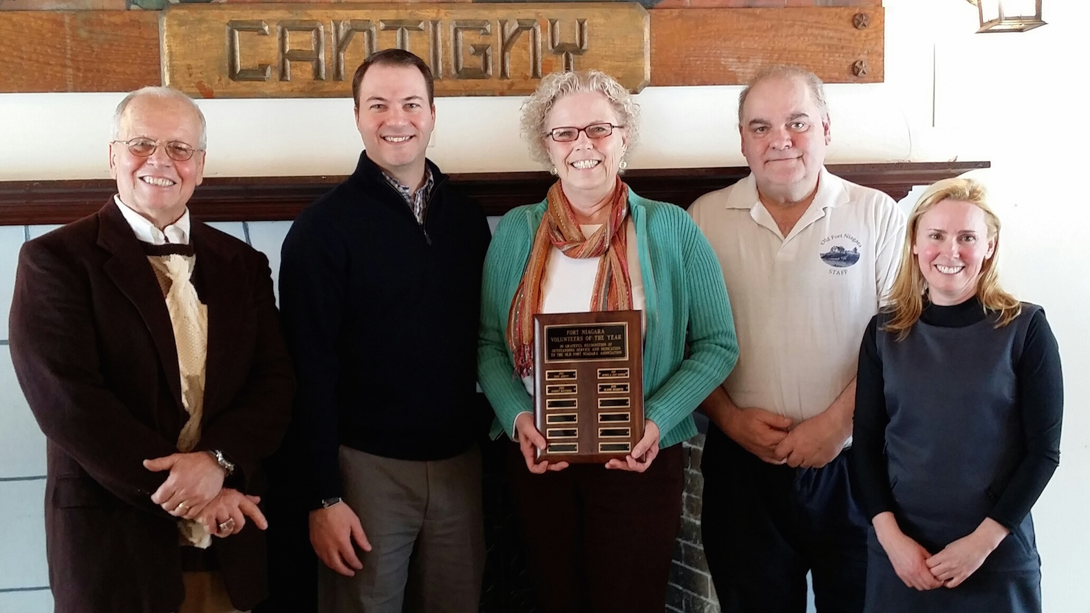Elaine Hildreth of Youngstown, center, is Old Fort Niagara's 2014 Volunteer of the Year. She is pictured with Old Fort Niagara Association Vice President Bruce Newton, State Sen. Rob Ortt, Old Fort Niagara Executive Director Robert Emerson and Volunteer Coordinator Genevieve Montante. Click for a larger image.