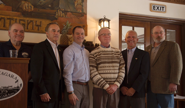 Thomas O'Brien of Youngstown, in the striped sweater, is Old Fort Niagara's 2015 Volunteer of the Year. He is pictured here with Old Fort Niagara Executive Director Robert Emerson, Congressman Chris Collins, Sen. Rob Ortt, Niagara County Clerk Joseph Jastrzemski and Old Fort Niagara Association President Dave Caldwell. (Photo by Lee Gugino)