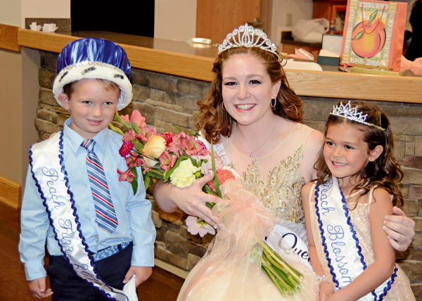 Lindsey Clark was crowned Peach Queen in September. She is shown, at right, with Peach Blossom Julianna Vanderhider, age 6, and Peach Fuzz Jack Thomas Sliwowski, 5. (Photo by Robin Clark)