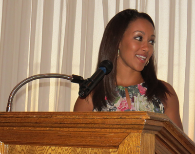 WKBW reporter Desiree Wiley addresses the Peach Queen dinner guests.