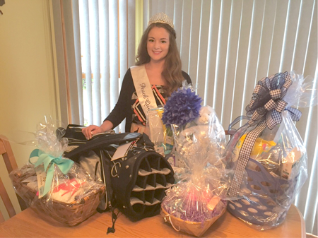 Niagara County Peach Queen Christine Oliveri is shown with baskets and prizes that will be available at her fundraiser for Wings Flights of Hope on July 26. (Contributed photo)