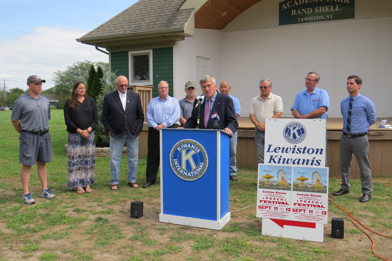 Jerry Wolfgang, center, and members of the Kiwanis Club of Lewiston join local elected leaders at a Peach Festival press conference Wednesday.