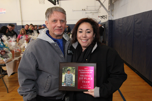 Dennis Brochey with gold star mother Gricela Dikcis, who holds a plaque honoring the memory of her son, Alan, who died in Afghanistan. (Find more photos in our gallery.)