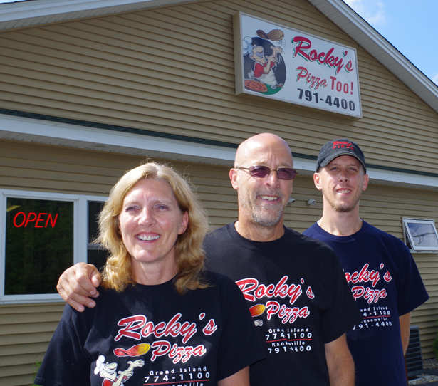 Cheri, Gregg and Jason Surniak are celebrating the fifth anniversary of the opening of Rocky's Pizza Too! (Photo by Larry Austin)
