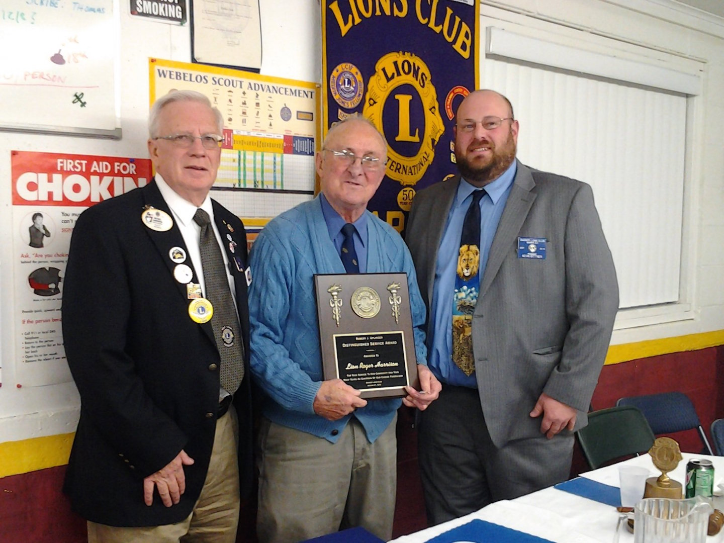 Lions District 20 N Gov. Mike, Lawkowski is shown with Lion Roger Harrison and Barker Lion's Club President Kevin Bittner. Harrison recently was presented with the Uplinger Award.