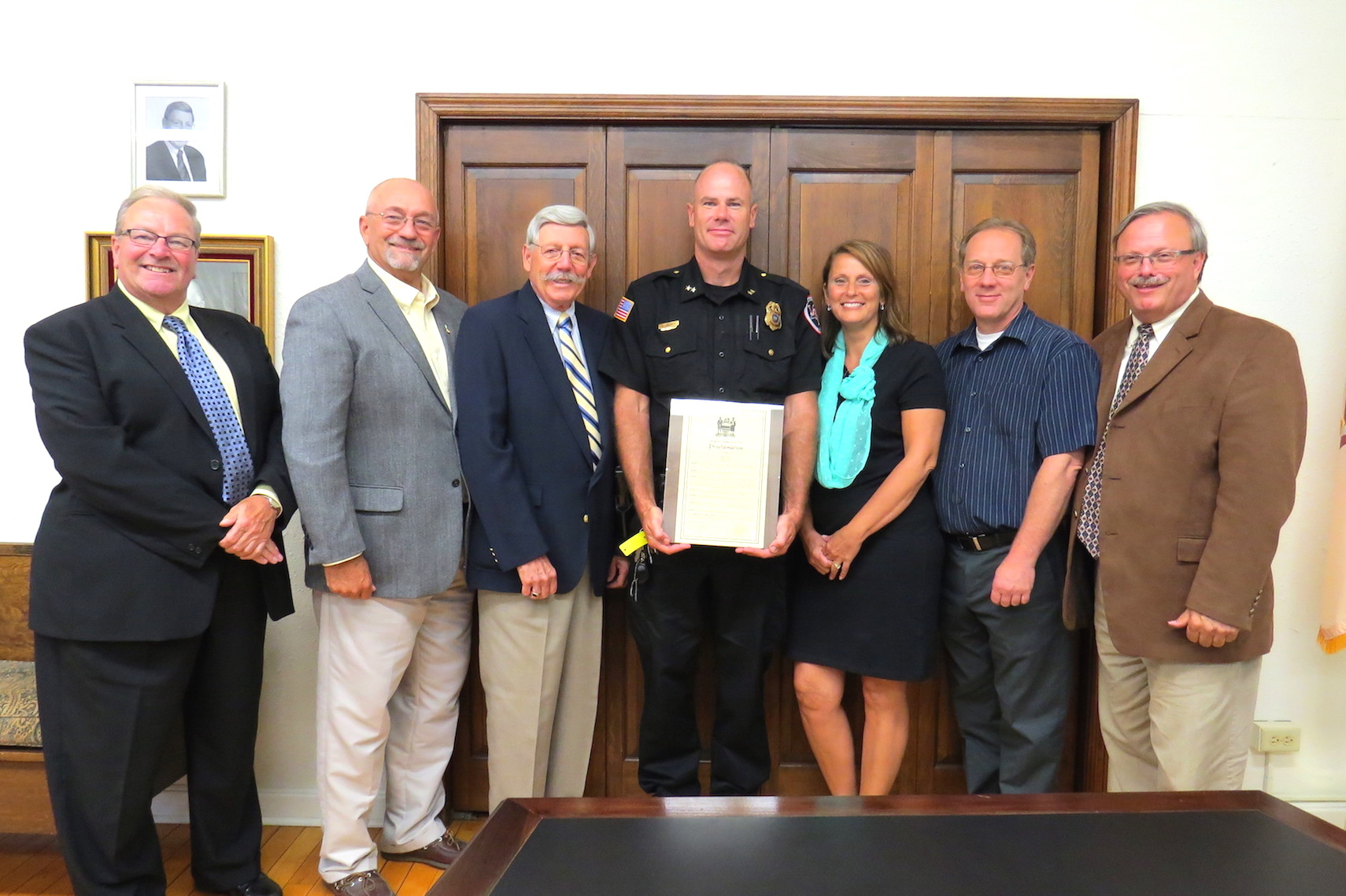Pictured, from left: Trustee Dan Gibson, Deputy Mayor Bruce Sutherland, Mayor Terry Collesano, Lewiston Police Chief Chris Salada, Clerk/Treasurer Amy Salada, Trustee Nick Conde and Trustee Vic Eydt. Click for a larger image.