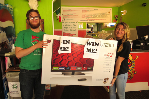 Matt and Maddie hold the 42-inch Vizio E Series Smart LED HDTV, which one lucky Spicey Pickle customer will win Tuesday, May 5.