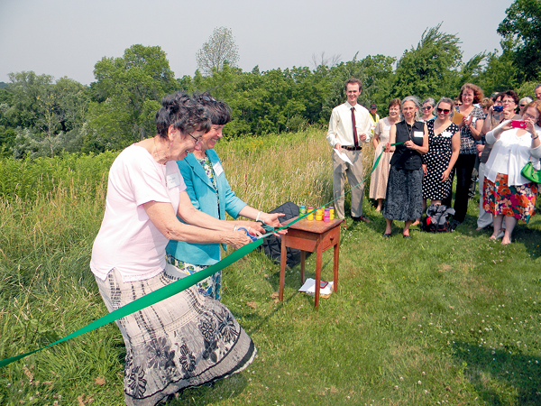 Sister Edith Wyss of the Sisters of St. Francis joins with Nancy Smith, executive director of the Western New York Land Conservancy, at Tuesday's ribbon cutting. (Photos by Terry Duffy)