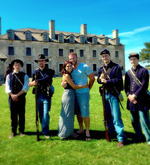 The newly engaged couple with members of the 49th Volunteer Infantry Regiment of the Greater Buffalo Area.