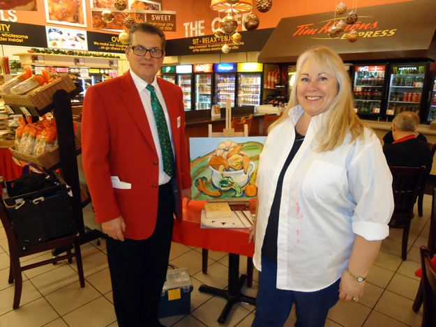 Anthony DiMino, president of DiMino Tops Lewiston, is shown with Michelle Marcotte in the carryout café where Marcotte paints.