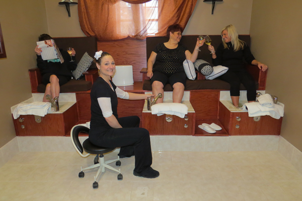 Tuscana Salon & Spa owner Jillian Zaccarella sits in front of her three-basin pedicure area. Click for a larger image.