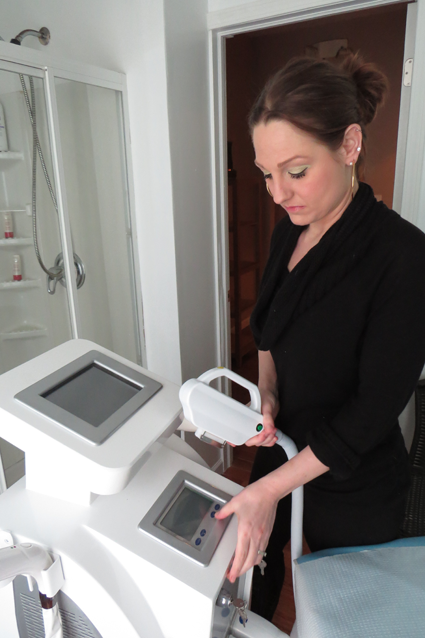 Tuscana Salon & Spa owner Jillian Zaccarella with her YAG laser.