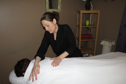 Tuscana Salon & Spa owner Jillian Zaccarella gives a massage.