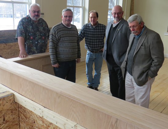 Village of Lewiston Deputy Treasurer Edward Walker, far left, trustees Vic Eydt, Nick Conde and Bruce Sutherland, and Mayor Terry Collesano look over the woodwork recently completed inside the new municipal boardroom.