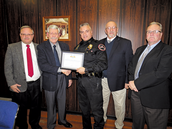 Lewiston Police Department Chief Frank Previte shared a certificate with the Village of Lewiston recognizing placement on the SafeWise.com list of safest cities in New York. He is pictured, center, with board members Vic Eydt, Mayor Terry Collesano, Bruce Sutherland and Dan Gibson.