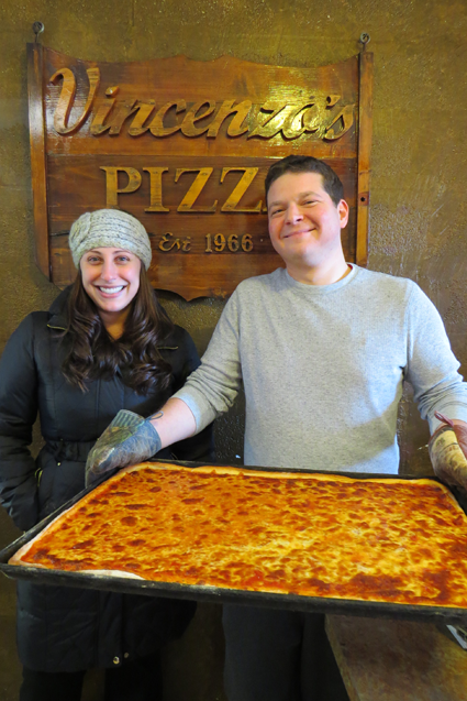 Sarina and David Munzi stand inside Vincenzo's Pizza House in Lewiston.