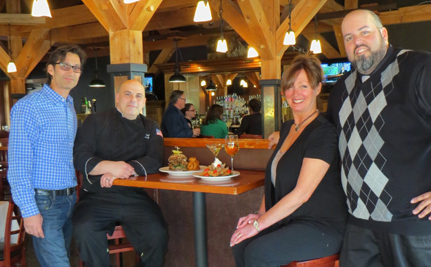 Pictured inside the River SideBar are, from left, Water Street Landing owner Jon DiBernardo, chef Paul Bunce, `den mom` Jayne Anderson and restaurant manager Matt Ott.