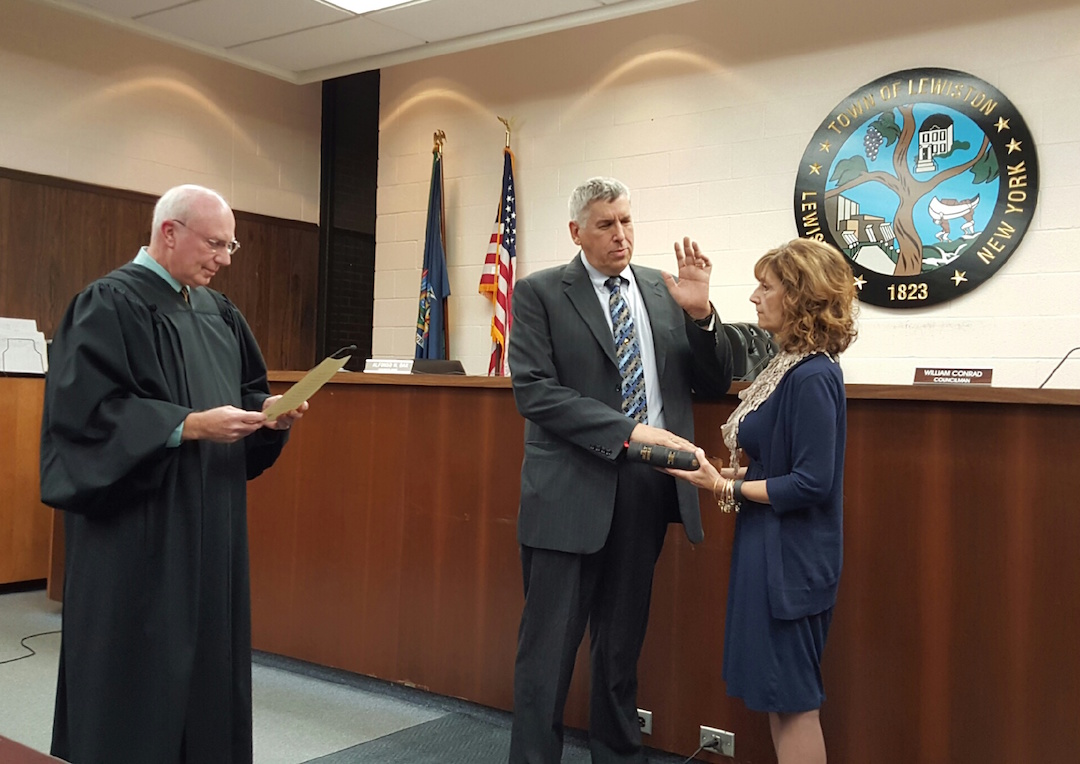 Town of Lewiston Justice Thomas Sheeran reads the oath to interim Supervisor Ron Winkley Monday as Winkley's wife, Laurene, holds the Bible. (Photo by Terry Duffy)