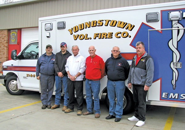 Shown from left in front of the Youngstown Volunteer Fire Co.'s new ambulance are Chief Eric Wieland, Kyle Nearhoof, EMS Capt. Tim Fogarty, President Al Smith, Denny Chmaj and Trustee Greg Robertson Sr.