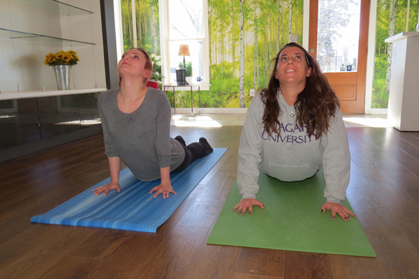 Hannah McGovern, left, and Alexis Butski practice yoga in the studio at 700 Center St., Lewiston.