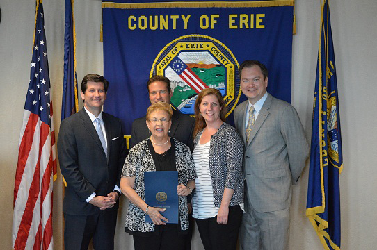 2015 Erie County Senior of the Year Rose Marie Hall (center, holding proclamation) is surrounded by Erie County Executive Mark C. Poloncarz (left), family members, and Erie County Senior Services Commissioner Randy Hoak (right) after being named Senior of the Year.