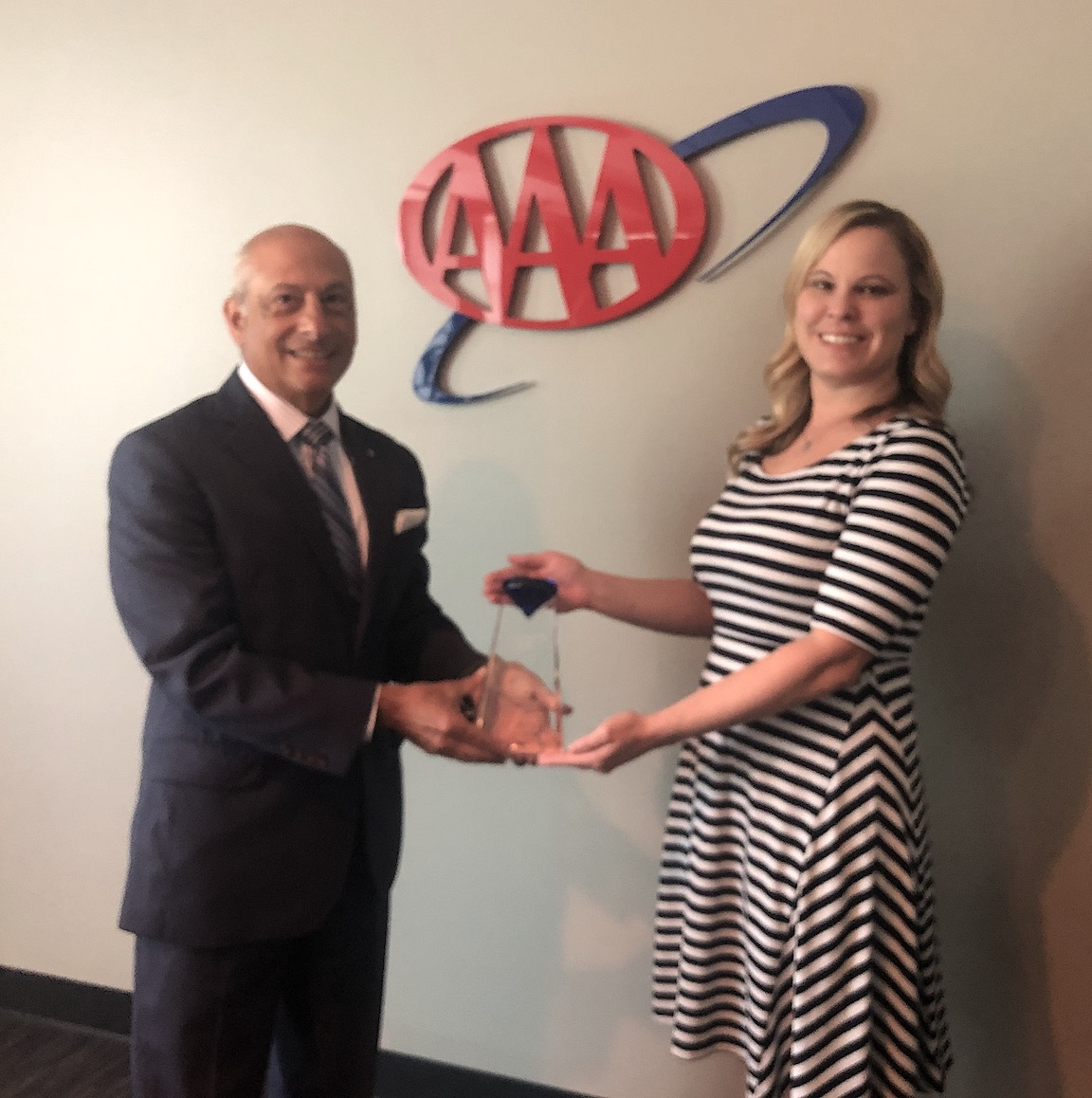 Tony Spada, president and CEO of AAA Western and Central New York and Stacey McConnell, vice president of insurance at AAA Western and Central New York, accepted a 2019 Top Performer Award from AAA for member use and growth for Insurance products.