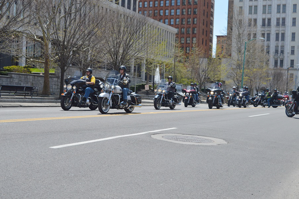 Riders roll out in brilliant sunshine in downtown Buffalo as the 26th annual ABATE motorcycle safety and awareness ride begins in front of the Edward A. Rath county office building.