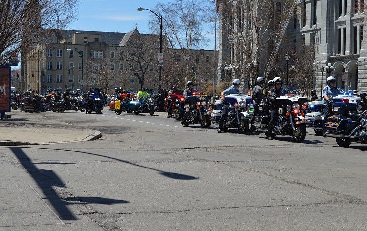 A police escort prepares to guide motorcyclists participating in ABATE's 25th annual safety and awareness ride. May is Motorcycle Awareness Month, and Saturday's rally downtown emphasized the need for all drivers to be vigilant and prepared to share the road with motorcycles.