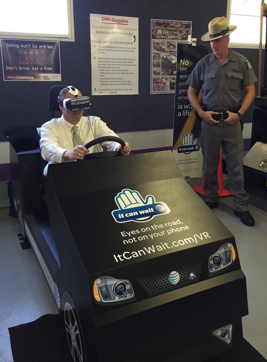 State Sen. Tim Kennedy tries the simulator.