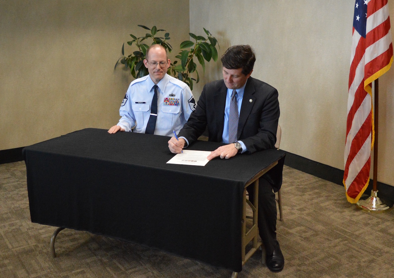 Erie County Executive Mark C. Poloncarz is joined by Kevin Nichols, public information officer for the 914th Airlift Wing (U.S. Air Force Reserve) to sign a proclamation prepared in advance of Armed Forces Week.