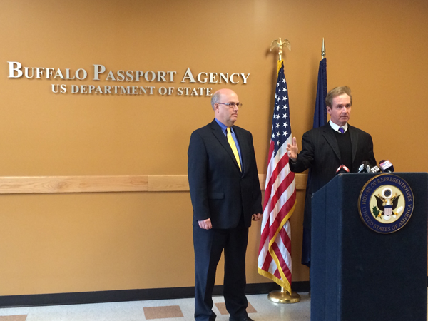 Congressman Brian Higgins speaks as Buffalo Passport Agency Director James Theis listens.