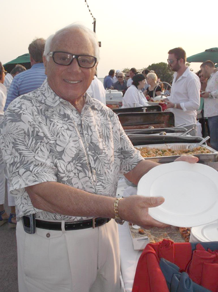 Russell J. Salvatore inspects the buffet line before his 300 guests indulge.