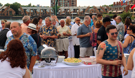 Russell J. Salvatore stands amidst partygoers at the July 4 event he sponsored.