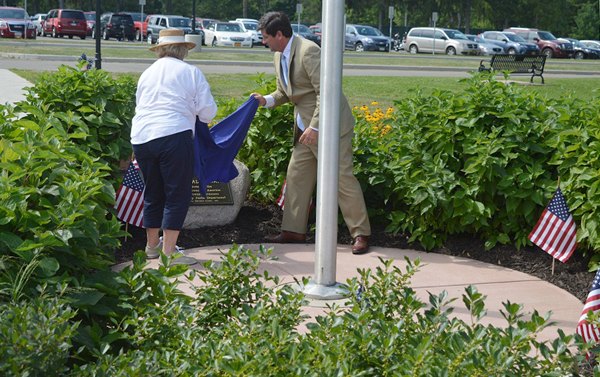 Erie County Executive Mark C. Poloncarz joins in the unveiling of the Blue Star Memorial Marker at Chestnut Ridge Park.