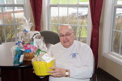 Peregrine's Landing Senior Community resident Bill Anderson with some of his winning baskets.