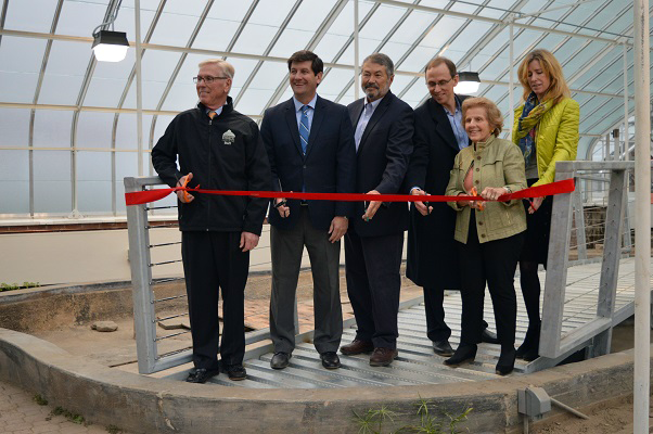 Erie County Executive Mark C. Poloncarz (second from left) joins Buffalo and Erie County Botanical Gardens President and CEO David Swarts (left), Erie County Legislator Lynne Dixon (right), and members of the gardens' board of directors to cut a ribbon in celebration of extensive renovations and improvements to houses 2 and 3 at the National Historic site.