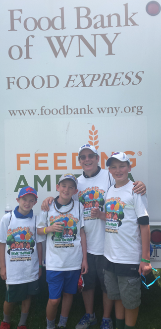 Pictured, from left: David, Charles, Tom and James Calderone at Walk Off Hunger.