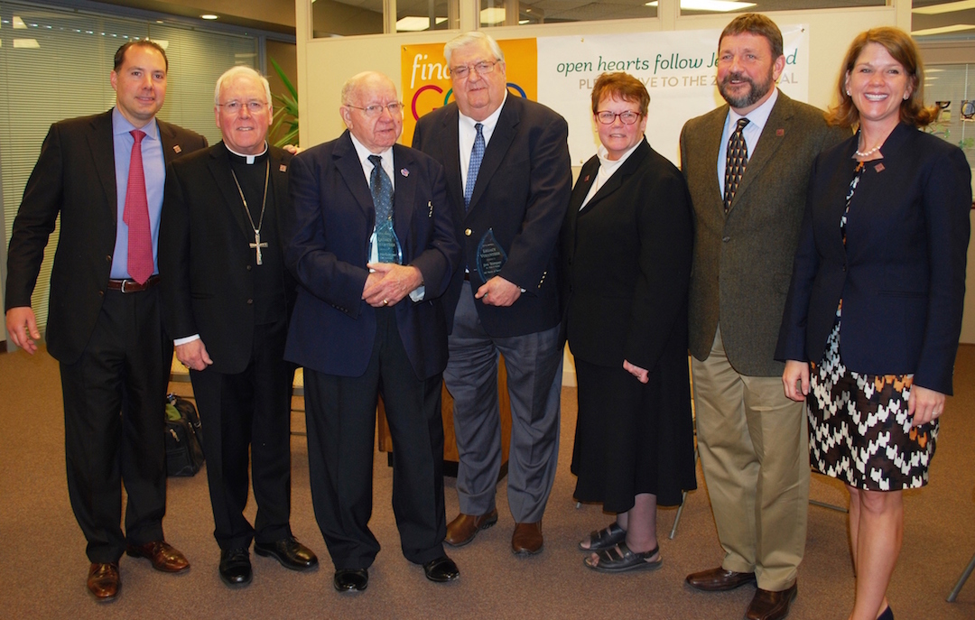 Holding their Legacy Volunteer Awards presented to them today are Bill Herberger, 90, and Jim Trimper, 75, who have given a collective 130 years of service to the Appeal. Pictured, from left: Nick Tzetzo, Appeal 2016 chair; Bishop Richard J. Malone, bishop of Buffalo; Herberger, Trimper, Diocesan Director Sister Mary McCarrick; CEO Dennis C. Walczyk and Nicole Tzetzo, Appeal 2016 chair.